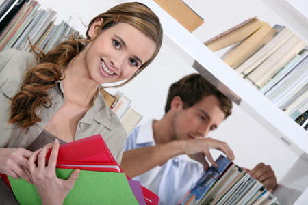 kids exercise: Students in library Stock Photo