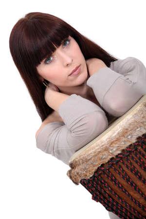 bongo drum: Brunette posing with bongo