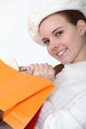 Woman hugging her shopping bags Stock Photo - 13541867