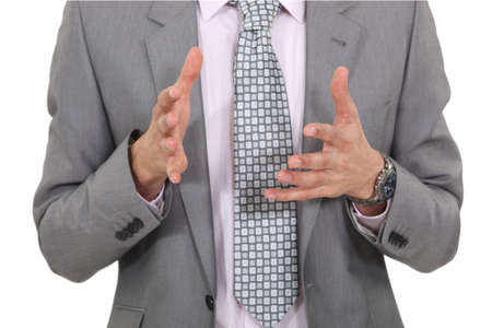 explain: Businessman gesturing with his hands Stock Photo