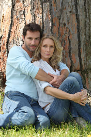under a tree: Couple under a tree
