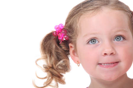 agitated: Little girl with pigtails Stock Photo