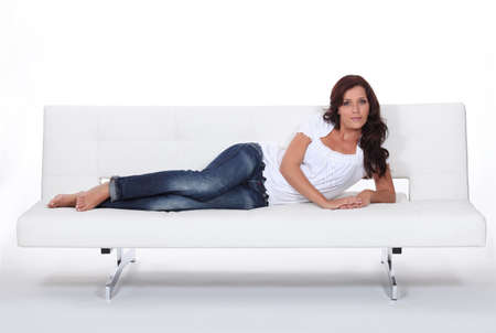 woman lying on a couch photo