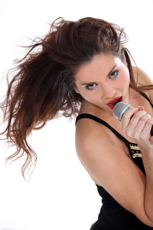 showbusiness: Attractive brunette singing into microphone