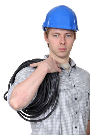 Portrait of electrician carrying coil of wire Stock Photo - 13542231