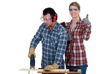 Woman inspecting carpenter photo