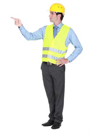 authoritative: foreman pointing at something looking authoritative Stock Photo