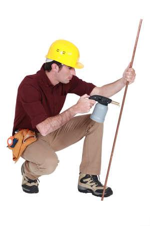 blowtorch: Tradesman using a blowtorch