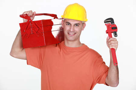 craftsman carrying toolbox over his shoulder and spanner photo