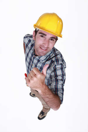 Manual worker giving the thumb up Stock Photo - 13541544
