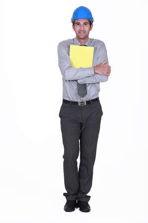 Man with helmet holding report Stock Photo - 13541172