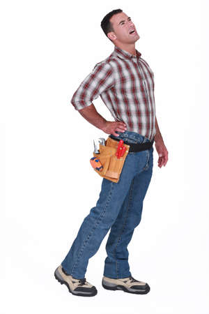 A handyman with his back hurting Stock Photo - 13541761