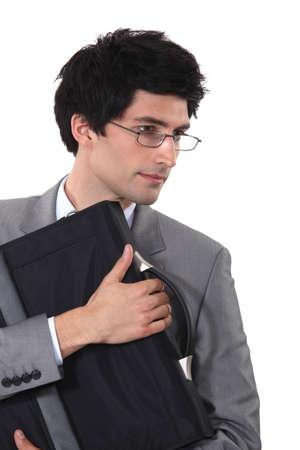 Man clutching a briefcase photo