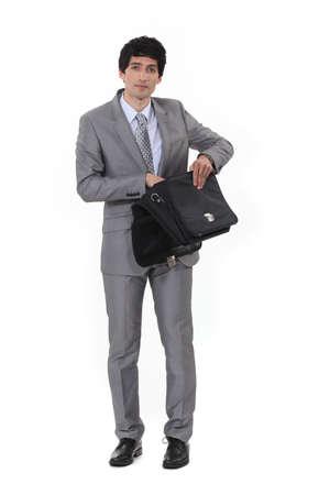 routing: Businessman routing through bag Stock Photo