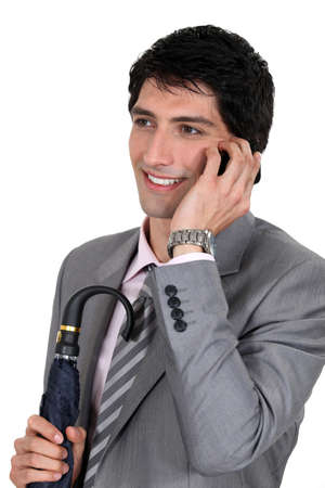 A polished businessman talking on his mobile phone Stock Photo - 13542339