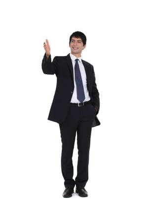 businesspartners: joven ejecutivo sonr�e todo el businesspartners de felicitaci�n Foto de archivo