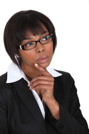 business skeptical: Thinking businesswoman Stock Photo