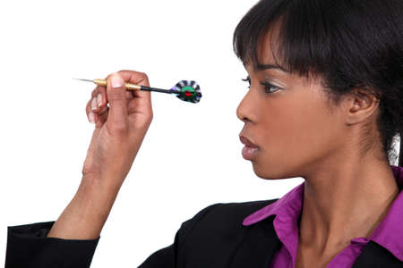 african business: black beauty playing darts Stock Photo