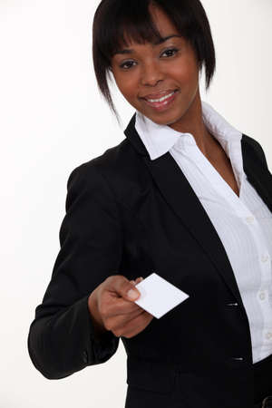 Businesswoman holding out card photo