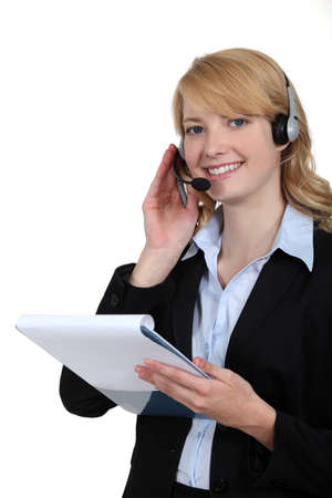 Woman with a telephone headset photo