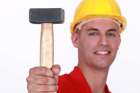 impact tool: Close-up of mason with lump mallet