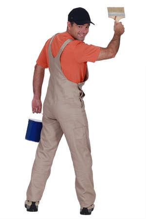 Handyman painting a wall Stock Photo - 13541240