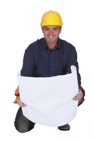 chirpy: Smiling tradesman looking at a blueprint Stock Photo