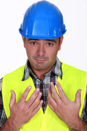 Construction worker holding his hands up Stock Photo - 13542342