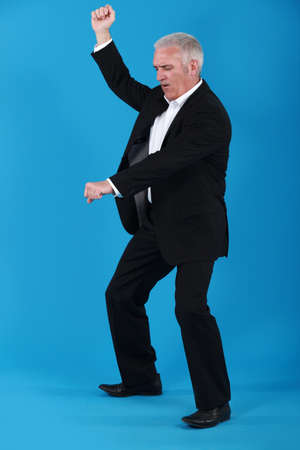 jump suit: mature businessman dancing
