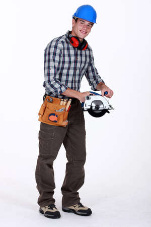smiling carpenter with circular saw Stock Photo - 13542010