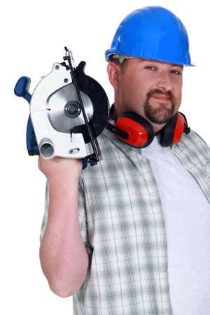 A plumb handyman with a circular saw  photo