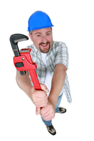 Chubby plumber holding adjustable wrench Stock Photo - 13541388