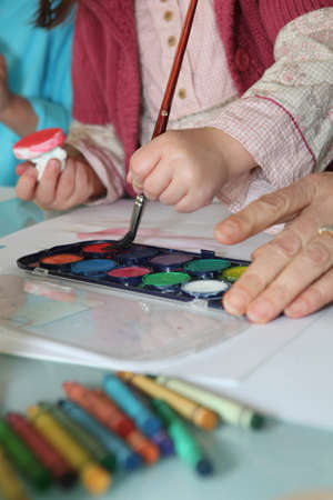 Close-up shot of creative child painting photo