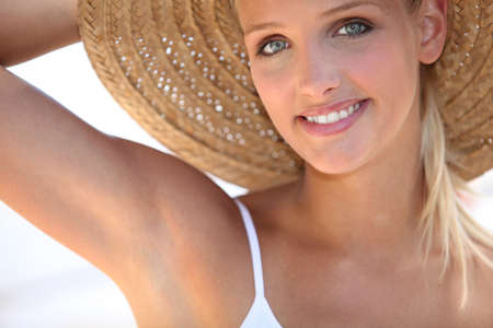 young couple smiling: young woman on vacation