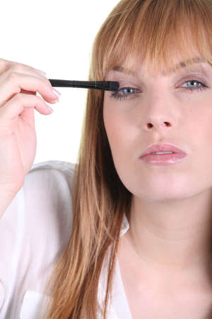 Woman applying eyeshadow Stock Photo - 13542156