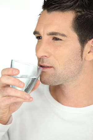 pureness: bust shot of man drinking glass of water Stock Photo