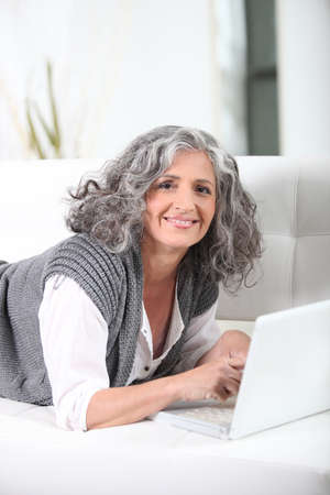Senior woman with a laptop photo