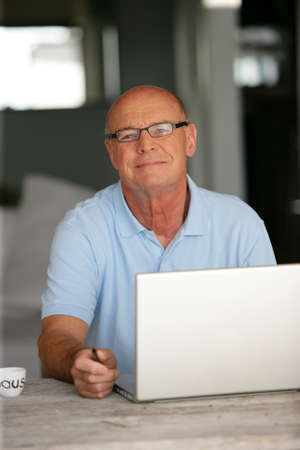 telecommuter: Bald man working from home Stock Photo