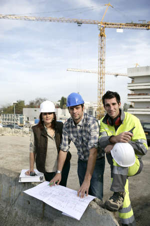 tradeswoman: A team of construction workers working together Stock Photo
