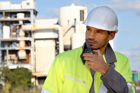 Foreman with a walkie talkie photo
