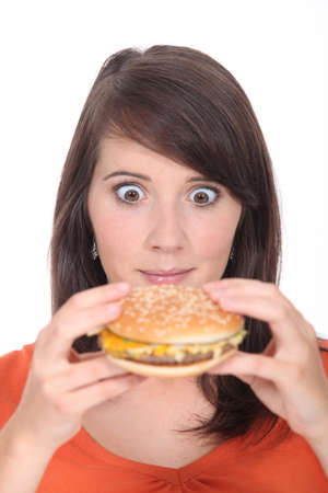 attacked: Brunette girl attacked Burger Stock Photo