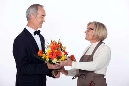 50 to 60: Man buying flowers Stock Photo
