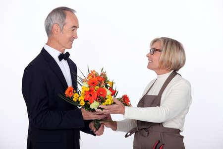 Man buying flowers photo