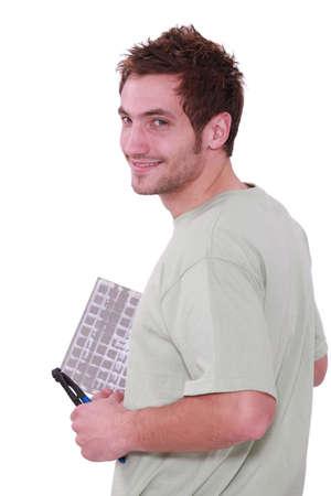tiler: A man laying tile