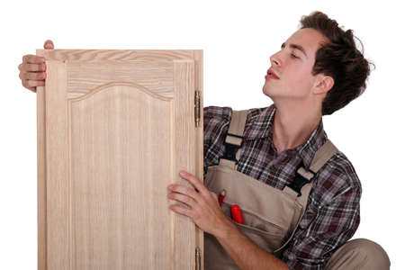 Carpenter with a cupboard door photo