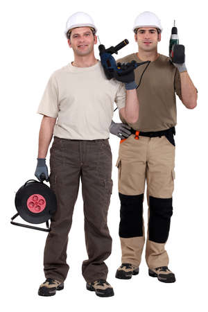 Two men holding power drills photo