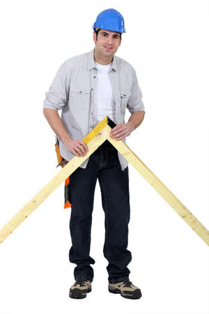 conservatories: Carpenter checking wooden joint Stock Photo