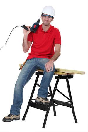 worktable: Arrogant handyman posing
