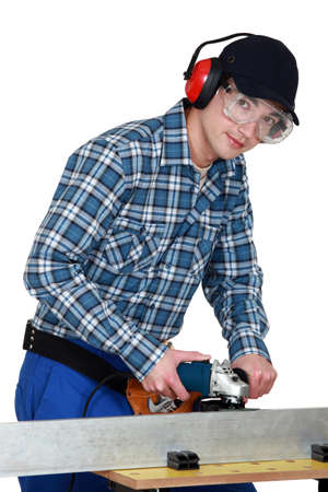 anti noise: Young man using hacksaw
