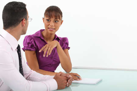 Businessman and woman in conversation Stock Photo - 13561086
